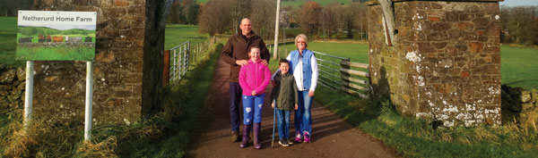 Andrew Adamson with his family at the entrance to their Peeblesshire farm