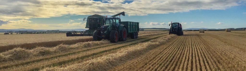 Baling straw alongside the combine